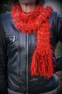 "This hand knitted ""firecracker scarf"" is a unique blended balance of oranges and reds. There is a strand of fluffy lash throughout so you and your jealous friends can ""ooh"" and ""aah""! So very soft and can help knockout pieces in a tired wardrobe. You can wrap and re-wrap this little popper!    This is a perfect in between season scarve, depending on how you wrap yourself up you can be super warm or just classy cool!"