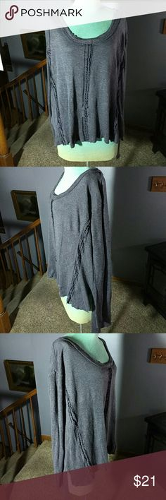 "Free People Sweater Light weight Grey cotton blend sweater with a scoop neck line in front has a high low hemline style and lace inserts on the front 29"" long is a looser fit Free People Sweaters"