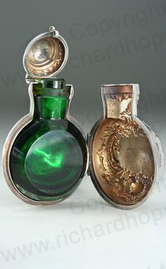 ANTIQUE 1901 SILVER SCENT PERFUME BOTTLE HOLDER WITH EMERALD GLASS BOTTLE. This item is sold. To visit my website to see what's in stock click here: http://www.richardhoppe.co.uk or for help or information email us here: info@richardhoppe.co.uk