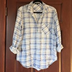 Cozy Flannel Tunic Super soft and cozy blue flannel tunic. Pocket on the front. No button open collar neckline. Worn a few times.  Good condition. Velvet Heart Tops Tunics