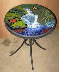 Loooooooovvve this water fall mosaic table