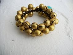 Simple Medium Brass Bells And Single Turquoise Stone Bracelet from goldbell on etsy