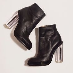 Black Leather Lucite Heeled Platform Bootie Black Leather Lucite Heeled Ankle Platform Bootie. Zip side. All Leather. Cool STILLETO HEEL INSIDE LUCITE CHUNKY HEEL. Lightly worn! Stand out piece for your wardrobe! Purchased in Hong Kong Boutique! Shoes Heeled Boots