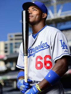 Dodgers outfielder Yasiel Puig strikes a pose before a game against the Padres at Petco Park in San Diego, CA. (Robert Beck/SI)