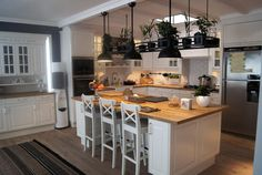 Kitchen island idea. I love the plants above!