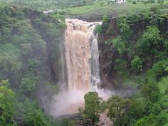 """#Patalpani_Waterfall_Indore – A perfect Family Picnic Spot - It is referred as """"patal"""" (which means hell), in the local language. They say that there is no idea as to the depth of the Kund and therefore, it derives its local name from that theory. However, the """"Kund"""" holds a sacred value to the local people. The waterfall, surrounded by the natural beauty of sky, earth and the trees is a good relaxation for the mind."""