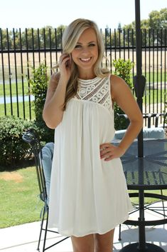 If you ever needed an excuse to shop, this dress is it. Unique crochet style at the bust and shoulder add a country classic feel to a solid ivory body. Loose style throughout with a key hole back desi