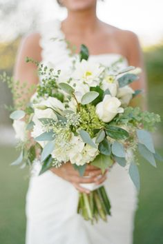 I love all the greenery in this and how simple it is. centerpiece