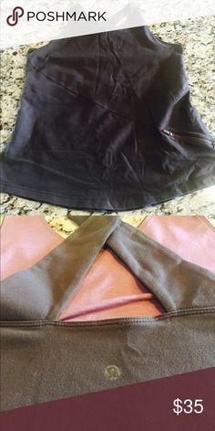 Lululemon Cross back dark brown lululemon! Size 8 has a zippy pocket in front! lululemon athletica Tops Tank Tops