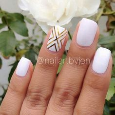 White nails with gold ribbons