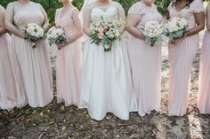 Pink bridesmaid dresses and  Pink fall wedding bouquet filled with seeded eucalyptus and pink english tea roses. I love these bronze Mischka Badgley open toe wedding day heels with crystal accents. Fall Wedding in the woods at Camp Linden in Linden, Michigan by Kari Dawson Photography and her team.