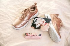 Check out the rose-gold sneakers Nike just debuted with Bandier. Get buying info on the hottest new sneakers of the season. They'll be on the top of every fashion girl's holiday wishlist. Nike Rose Gold Sneakers, Rose Gold Shoes, Shoes Sneakers, Sneakers Style, Grey Sneakers, Classic Sneakers, Converse Shoes, Women's Shoes, Nike Shoes Cheap