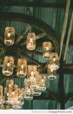Cartwheel + glass jar light fixture. Great for the patio