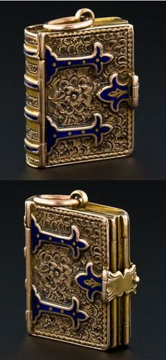 Antique Victorian book locket. This piece is from the mid-1880′s and is made of engraved 14k gold and blue enamel. It was sold by Lang Antiques