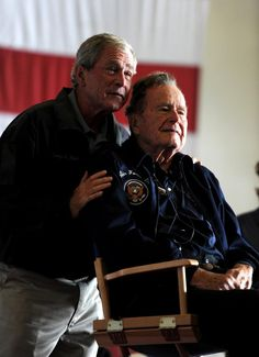Former Presidents George W. Bush and his father, George H.W. Bush, deliver remarks to the crew during a ceremony aboard the aircraft carrier USS George H.W. Bush (CVN 77).    The Navy's newest aircraft carrier hosted the ship's namesake, along with his family and friends, for a promotion and reenlistment ceremony in the ship's hangar bay off the coast of Maine during a scheduled underway-training evolution.