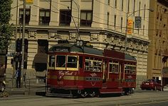 """Pretty! Original description: """"W6 class 1000 was photographed in Spencer Street at Collins Street in 1996. 1000 is one of a number of trams refurbished and repainted for use on Melbourne's City Circle tram route. The City Circle involved the first new street track constructed in Melbourne's Central Business District for many years.""""."""