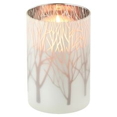 White glass candleholder with silver-hued trees.   Product: CandleholderConstruction Material: Frosted glass...
