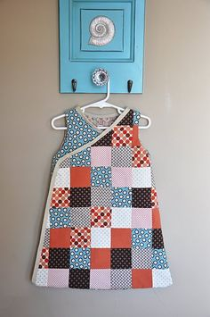 """Patchwork crossover jumper.  Mix this with the """"bias border"""" from http://pinterest.com/pin/37577616 and possibly offset the squares."""