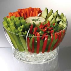 Party Bowls On Ice  Keep your vegetable or fruit trays cold for long periods of time! This is especially helpful if you are attending a party and have quite a drive ahead of you. The larger bowl has a detachable divider, so you can also use it for salad or other cold dishes.