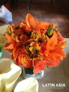 bright orange roses, lilies and alstroemerias, affordable yet super bright! by wedding cancun by LATIN ASIA