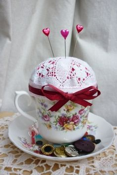 vintage teacup pincushion £9.00 by Lonely Hearts -- This gives me a gift idea for Rachel. I think I'll look for a great deal on some cracked china! Maybe I can find a teacup in OCR! Feb/15