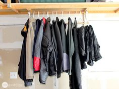 Install a beam to hang wet jackets and snow-pants on. 38 Borderline Genius Ways To Organize Your Garage Attic Staircase, Attic Ladder, Attic Loft, Basement Stairs, Attic House, Attic Library, Attic Office, Attic Playroom, Attic Renovation