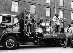 Jack Bruce, Ginger Baker, Eric Clapton, performing live on the back of a truck, shooting the film 'It was a Saturday Night'