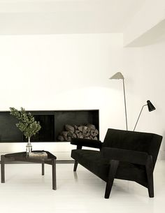 UES Home - In this vignette, a Pierre Jeanneret sofa and low table keep company…