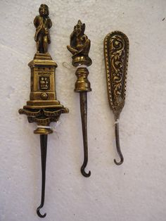 Button hooks, when shoes had many small, firm buttons it was necessary to use these hooks to fasten the shoes/boots.