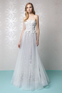 Strapless A-line Silver Tulle dress with a Silk flower embroidered bust.