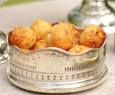 With a crackly shell and a light, pillowy middle, gougères, also called cheese puffs, are one of the most perfect foods to pop in your mouth between sips of your favorite adult beverage (they're delicious with Champagne). The Parmesan and bacon add a rich, savory flavor that makes them difficult to stop eating.