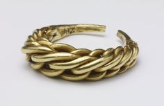 Gold finger-ring; 10th-11th c; Oxford, England  Formed from six plaited gold rods of circular section and tapering towards the ends, which are beaten together to form a plain narrow band; this has parted in one place, but presumably in antiquity as both ends are smooth.  Medium: gold; plaited, beaten
