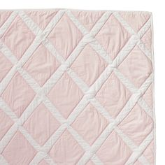 Pink Diamond Quilt  Rows of diamonds are hand-appliquéd on this thick lofty quilt, creating wonderful imperfections and texture. 100% cotton percale is stonewashed for incredible softness. Shell pink diamonds appliquéd on white; solid white on reverse.