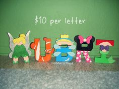 I LOVE this!! I will be doing this for Rylee! Etsy listing at https://www.etsy.com/listing/162624742/disney-assorted-character-letter-art