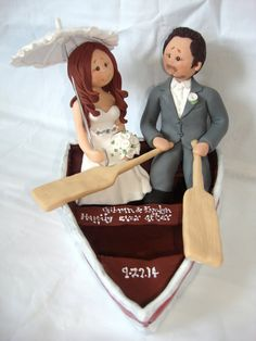 Bride and Groom in a boat wedding cake topper by ALittleRelic