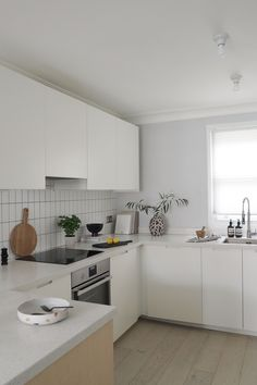 White IKEA kitchen with custom made fronts - IKEA kitchen hack