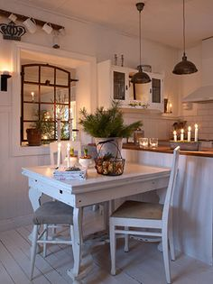 Cosy Scandinavian kitchen with internal window all decorated for Christmas