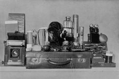 'Ghost-hunting kit' of British psychic researcher, Harry Price (1881 – 1948): reflex & cinematograph cameras, tools for sealing doors & windows, apparatus for secret electrical controls, steel tape, drawing instruments, torch, bottle of mercury, powdered graphite for developing finger-prints, etc.