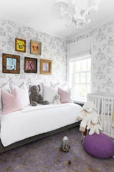 Wallpapered kids room with daybed and rabbit painting.