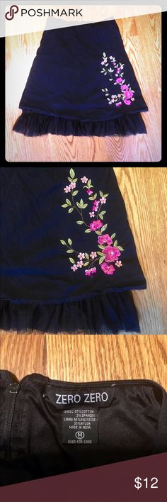 Skirt Really a fun skirt! Black with beautiful embroidered pink flowers on the bottom. Fully lined with an edge of tulle for a little bounce and a lot of fun. Great shape! Zero Zero Skirts