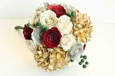 Alternative bridal bouquet entirely handmade from books with hydrangeas, roses, berries.