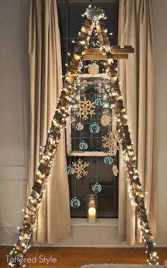 cool unique christmas trees ladder.  I REALLY like this.  I have my Grandfathers old ladder, all paint stained and rickety.  It would be wonderful to honor it like this.