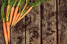 raw vegetables food carrot top view on old wooden background
