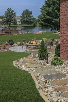 Would love to see a view like this walking into my backyard! Perfect outdoor living space with natural stone from Semco Stone.