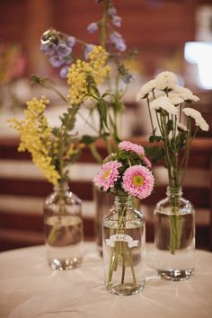 I love the simplicity of these flowers.. we will also have mason jars to fill at the venue..