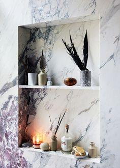 built-in marble shelving in the bath | jenna lyons house tour on coco kelley