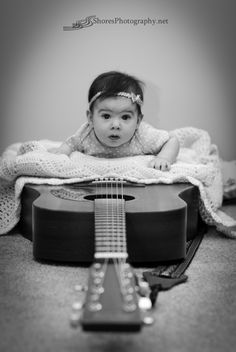 Never too young to play a Martin guitar. #infant #photography