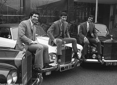 Music manager Gordon Mills, centre, and two of his singers Tom Jones, left and Engelbert Humperdinck sit on the bonnets of their Rolls Royce...