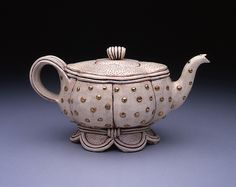 a professor i had, Gail Kendall, made this beautiful teapot with gold luster.