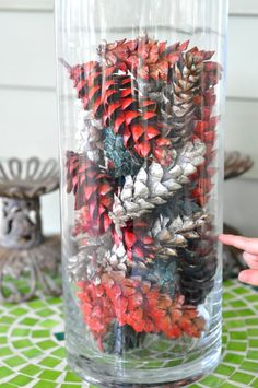 1. find pinecones 2. spray paint them fall colors and let dry 3. put them in giant decorative vase. DONE!